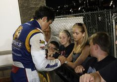 Hendrick Motorsports driver Chase Elliott signs autographs for fans after winning the NASCAR KN Pro Series East-West combo event at Iowa Speedway on May 19.