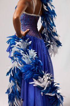 "The Rockettes ""Gershwin Boa"" costume was designed by Erté and was introduced in 1990.  #feathers #rockettes #blue #NYC #costumes #dancers"