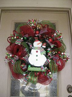 Christmas Mesh Wreath: Start with using a green wreath.Need 2 colors mesh, ribbon,ornaments,glitter ball sticks, curly sticks,snowman or santa for middle.