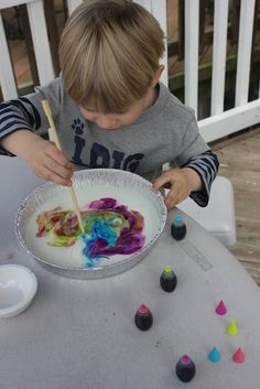 Rainbow painting with milk and food coloring.....hours of fun