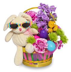 "This year, instead of a basket full of candy, why not fill it with other Easter and springtime favorites, such as flowers! I know what you're thinking, ""Flowers for kids? No way!"" But really, flowers teach kids about spring and the changing seasons. Everyone loves Easter flowers, even kids."
