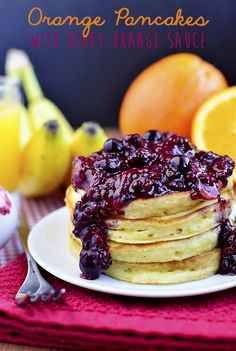 Orange Pancakes with Warm Berry-Orange Sauce via Iowa Girl Eats