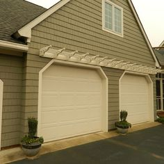 Learn how this homeowner dressed up his garage on a shoestring budget with a DIY pergola.   thisoldhouse.com/yourTOH
