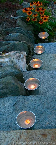 galvanized buckets filled with sand and a tea light