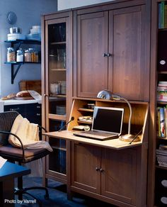 Bet you never thought you could convert your dining room cabinets into a home office. See how it's done. #office #cabinets