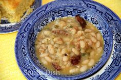 Cajun White Beans with Rice - White beans, typically Great Northern or Navy, seasoned with the Trinity, garlic, green onion, parsley, bacon and andouille sausage, and served over white rice.