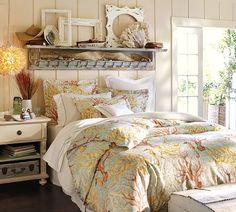 Love the shelf and frames over the bed.