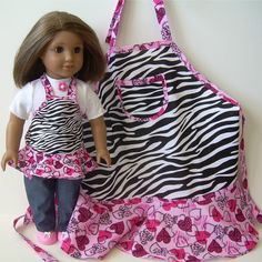 Matching aprons - The aprons are made of crisp cotton and feature a fabric combination of pink and red hearts and zebra prints Each apron has a wide flounce at the hem, and the child's apron has a pocket on the front.