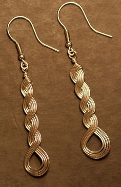 """Sterling Silver (argentium) earrings made using """"Wirely"""" wire weaving technique when multiple wires are woven together and kept together with tension."""
