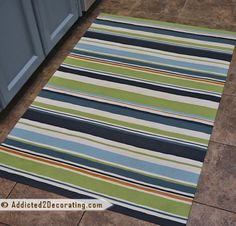 the kitchen needs a floor mat.  i would choose a fancier fabric though.