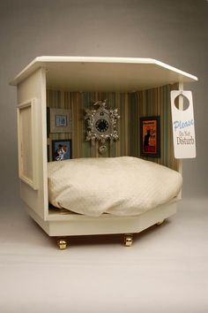 Mancat Mancave: DIY Pet Bed Project- I see these hideous side tables everywhere. What a great project to transform one.
