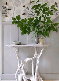 a #table from #driftwood, painted #white