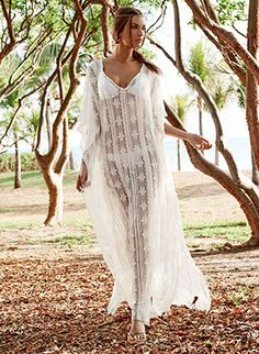 This breathtaking dress features to-the-floor length, relaxed fit, deep neckline and see-through lace design by Pily Q Swimwear, $214.00 #bohochic #boho #bohemian #pilyqswimwear #pilyqswim #lace #lacedress #beachwedding #destinationwedding #bridal