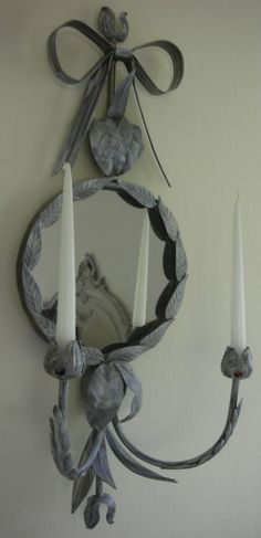 Love this candle sconce