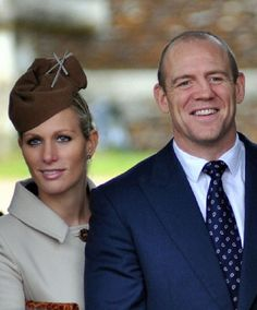 Zara Philips and her husband, British rugby player Mike Tindall leave after the St. Mary Magdalene Church Christmas Day service on the Royal estate in Sandringham