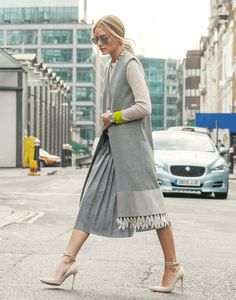 Olivia in Tibi pleated culottes with a Nom De Mode vest layered over a Chinti and Parker sweater, a Capwell + Co necklace, Dior aviator sunglasses and Gianvito Rossi heels.