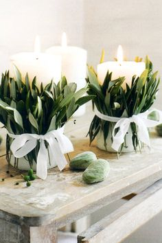 Candles wrapped with dried eucalyptus leaves and ribbon (1-lb bag of dried eucalyptus leaves, $16.95)