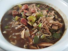 A yummy turkey gumbo make from your leftover holiday turkey. It's one of our favorite recipes from Emeril and never fails to please Miss Information Blog  #Soup #Turkey Gumbo #Emeril