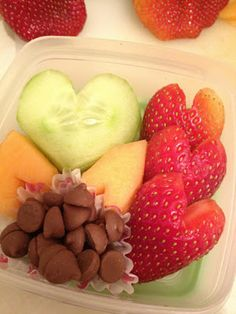 Cute Valentine's Snack of heart shaped fruit, cucumbers and chocolate.