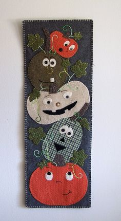 Reclaimed wool wall hanging- Stack of Sqaush. $60.00, via Etsy.