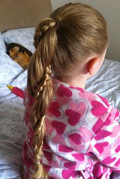 Rapunzel Twist Ponytail - I did this with Lily's hair today (8-21-13). She even held still while I did it! :)