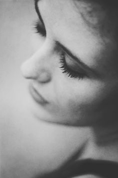 Super shallow DOF, shot from above focused on eyelashes (eyes looking down) open directional light