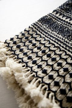Handwoven and embroidered wool throw