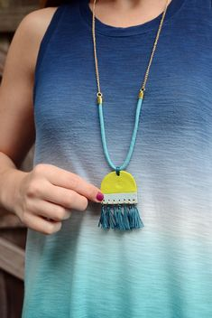 Learn how to make a clay pendant tassel necklace that is a bold, in-your-face statement piece that will surely garner compliments over and over again.