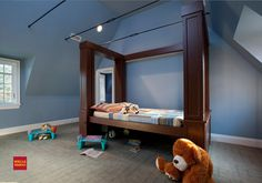 the bed is on a platform that raises and lowers up the poles to make a play area underneath the bed when raised.