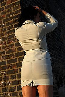 Visible Garter Bumps Under Tight Gray Skirt