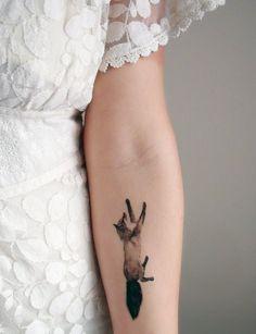 fantastic black watercolor tattoo fox design on girl's forearm