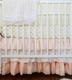 This ruffle crib skirt paired with gold polka dot crib sheet is a match made in nursery heaven! #nursery