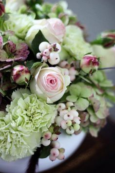 Beautiful old-fashioned floral arrangement ~ snowberries, pierre spray garden roses, mint green carnations, and antique hydrangea with some red grasses