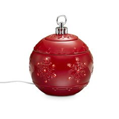 "Christmas Traditions ScentGlow® Warmer  Item #:  P90778  Let this classic Christmas icon fill your home with wonderful fragrance. Our electric ceramic warmer uses a warming plate to release the fragrance of Scent Plus® Melts, or scented oil,  sold separately. Hidden LED provides a welcoming glow. Includes three glazed ceramic pieces. Use without the lid for a stronger scent. 6"" h, 5"" dia.   Reg Price:  $35.00 each  Sale Price: $12.00 each"