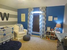 A solid #blue wall looks modern and cool with #gray and #white #chevron in this boy's #nursery.