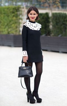 Miroslava Duma wears Valentino at Paris Fashion Week Spring 2014.