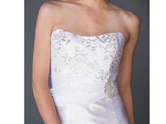 This eco-friendly gown would be awesome for a winter wedding | Fair Trade Metallic Silver Lace Gown | Green Bride Guide