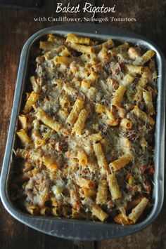 This easy and comforting Baked Rigatoni with cauliflower, sausage and tomatoes is a hit with my entire family!  www.mountainmamacooks.com