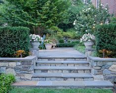 steps in terraced backyard - with pavers up to patio.