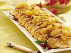 Take a coffee cake break!  This tempting coffee cake is filled with cream cheese and topped with apples, cinnamon and walnuts.