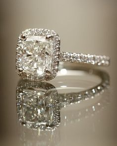 rectangular cushion cut! like a tattoo ring idea better but this isnt bad.