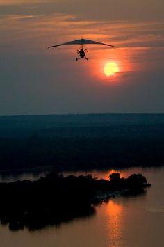 Microlight flight over the #Zambezi #Livingstone #Zambia at sunset. Stunning photo!