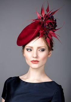 Rachel Trevor Morgan, A/W 2014. Red fur felt button beret with silk tartan roses and arrows feathers.