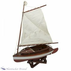 "Catboat Sailboat Model is 18"" tall, 14"" long and 6"" wide. Made of wood, with a canvas sail that you can reposition"