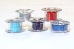 Use plastic tubing to keep bobbins from unraveling