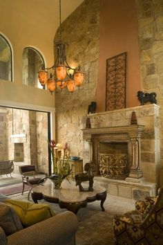 100s of Indoor Fireplaces  http://www.pinterest.com/njestates/indoor-fireplace-ideas/   Thanks To  http://www.njestates.net/ living rooms, tuscan decor, indoor fireplac, family rooms, stone walls, living room designs, wrought iron, stone fireplaces, wall design