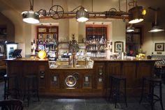 Steampunk bar with funky industrial lighting at U Bulino in Prague