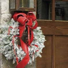 "Wintry Wreath | You can dress a standard wreath in white Christmas fashion as quick as you can say ""St. Nick."" All you need to get a decorator look is an inexpensive evergreen wreath, available at garden stores and tree lots, and a can of white flocking spray. 
