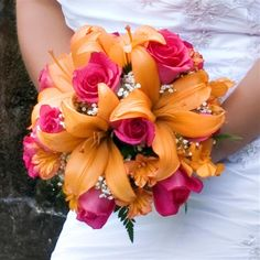 lilly and rose bouquet (coral or blue roses I dont know if lillys come in any other color)