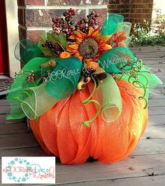 This aDOORable mesh pumpkin measures 22 in length and 25 in width. Its made with orange mesh, three different colors of green mesh for the